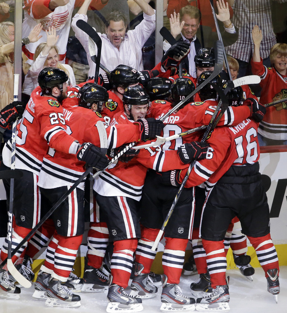 Chicago Blackhawks defenseman Brent Seabrook celebrates with his teammate after scoring a game winning goal during the overti