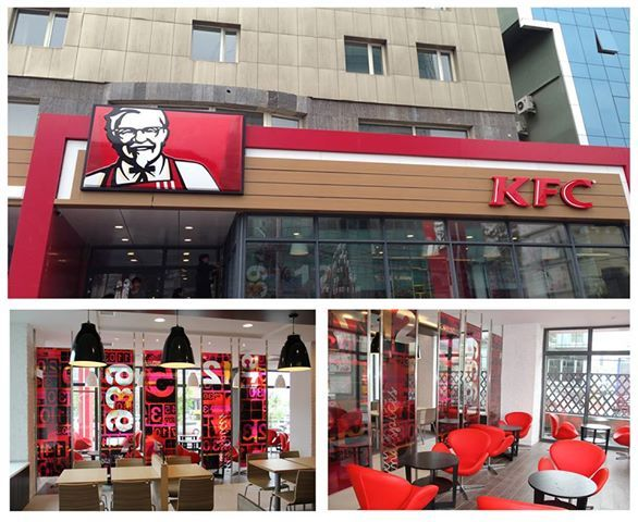 Colonel Sander's image beams from the storefront of Mongolia's first KFC location.