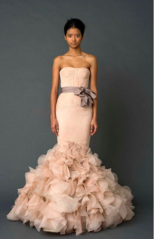 We don't know what we love most about this dress -- the gorgeous silhouette, the bold ruffles, or the dusty rose palette. It'