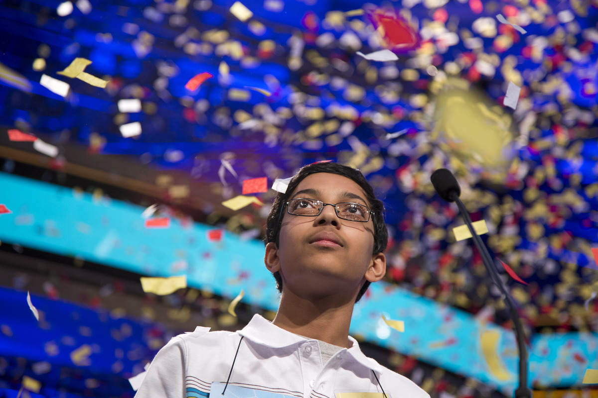 Arvind Mahankali, 13, of Bayside Hills, N.Y., watches as confetti falls after he won the National Spelling Bee by spelling th
