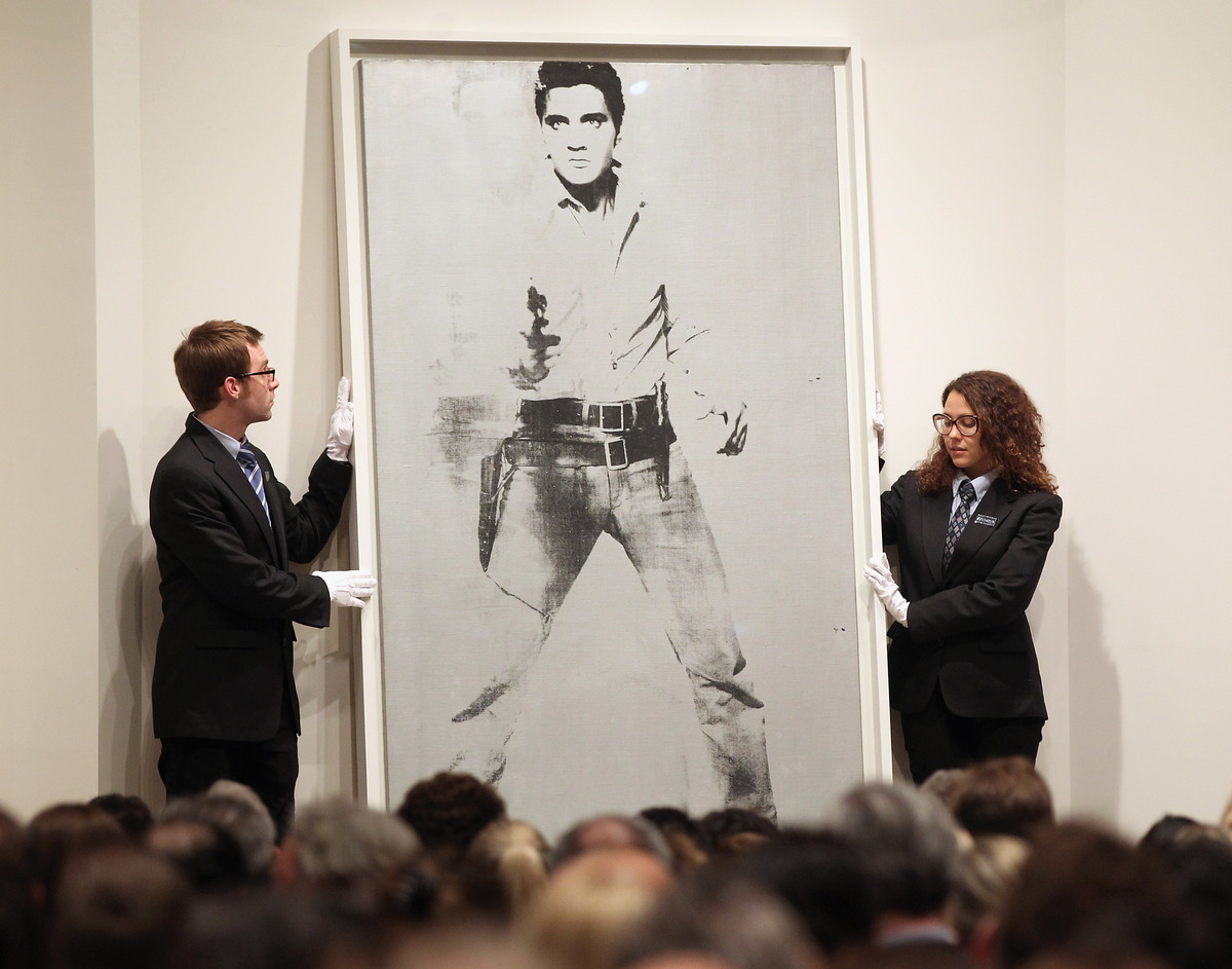 And Warhol's 'Double Elvis (Ferus Type)' portrait of Elvis Presley is auctioned at Sotheby's on May 9, 2012 in New York City.