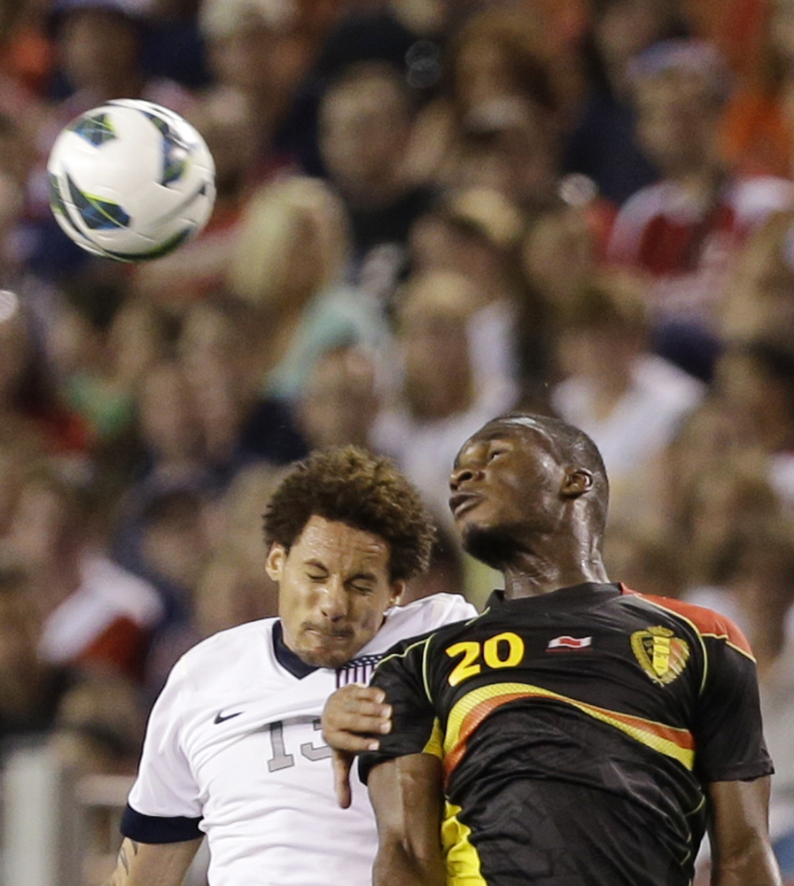 Belgium forward Christian Benteke (20) heads the ball away from United States' Jermaine Jones (13) in the second half of an i