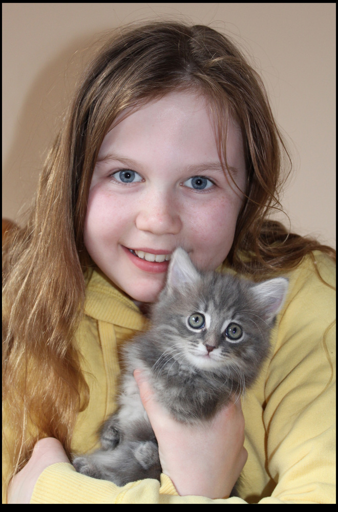 Abbey Morris with brave kitten Petal.  Brave kitten Petal has been born with a rare condition radial hypoplasia that means sh