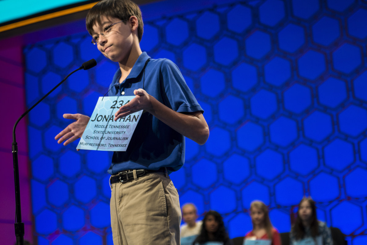 Jonathan Caldwell, representing Tennessee, reacts to misspelling a word during the semifinal round at the Scripps National Sp