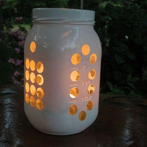 Mason jars take a mod-yet-ethereal look as Mason jar luminaries. This project involves painting Mason jars around stencils to