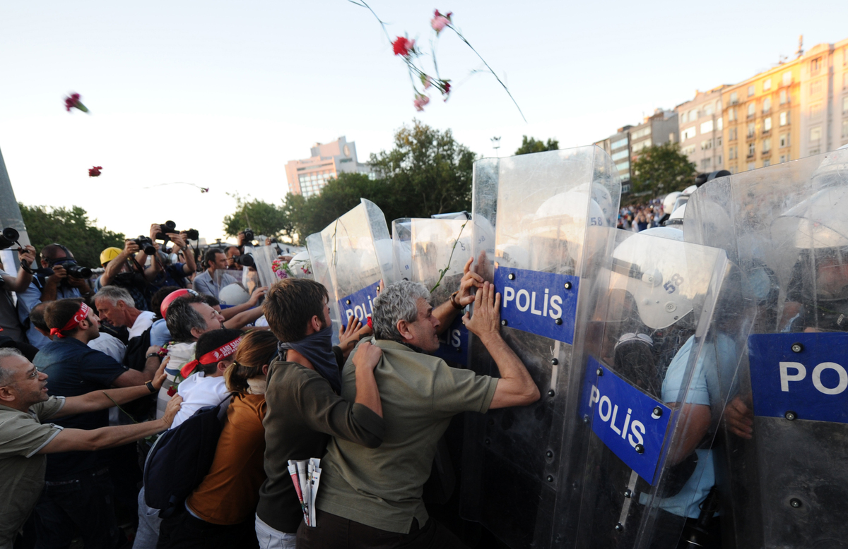 Turkish protesters clash with Turkish riot policemen on Taksim square in Istanbul on June 22, 2013. Turkish police used water