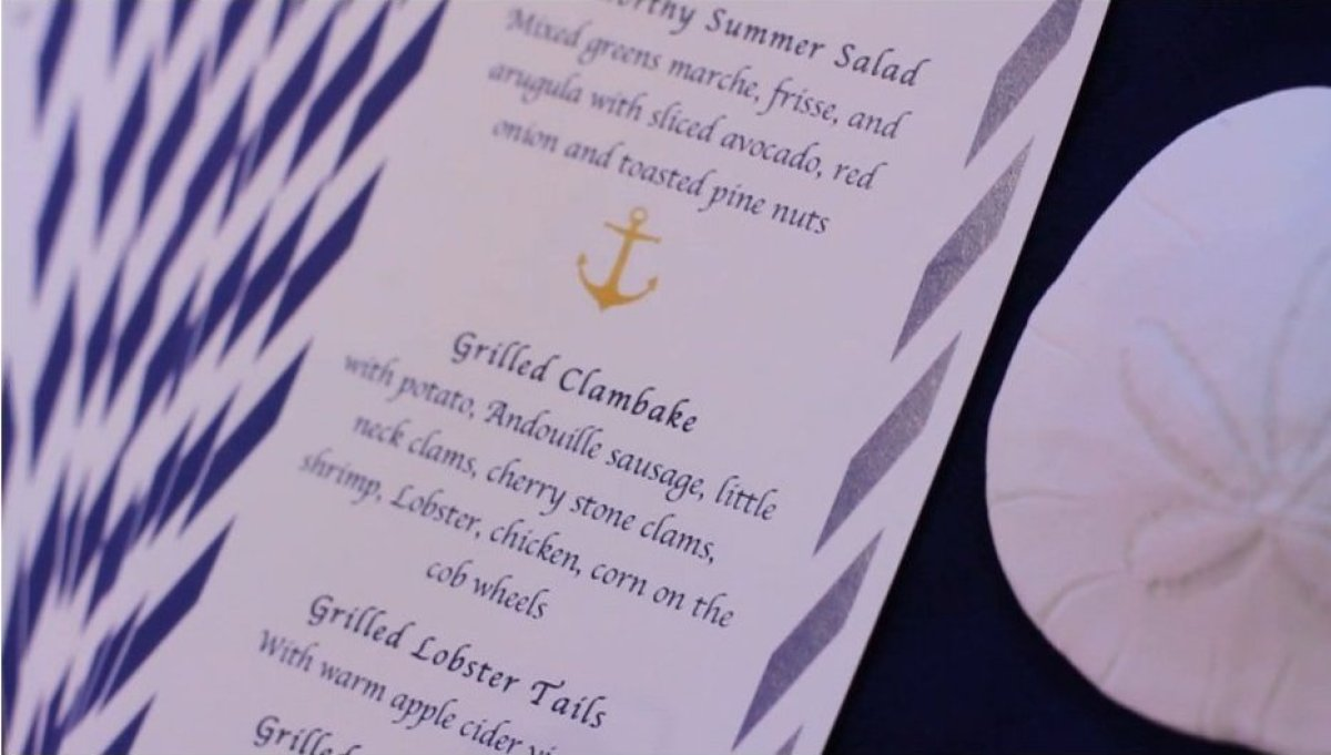 A nautical theme inspired the menu cards, linens and place settings.