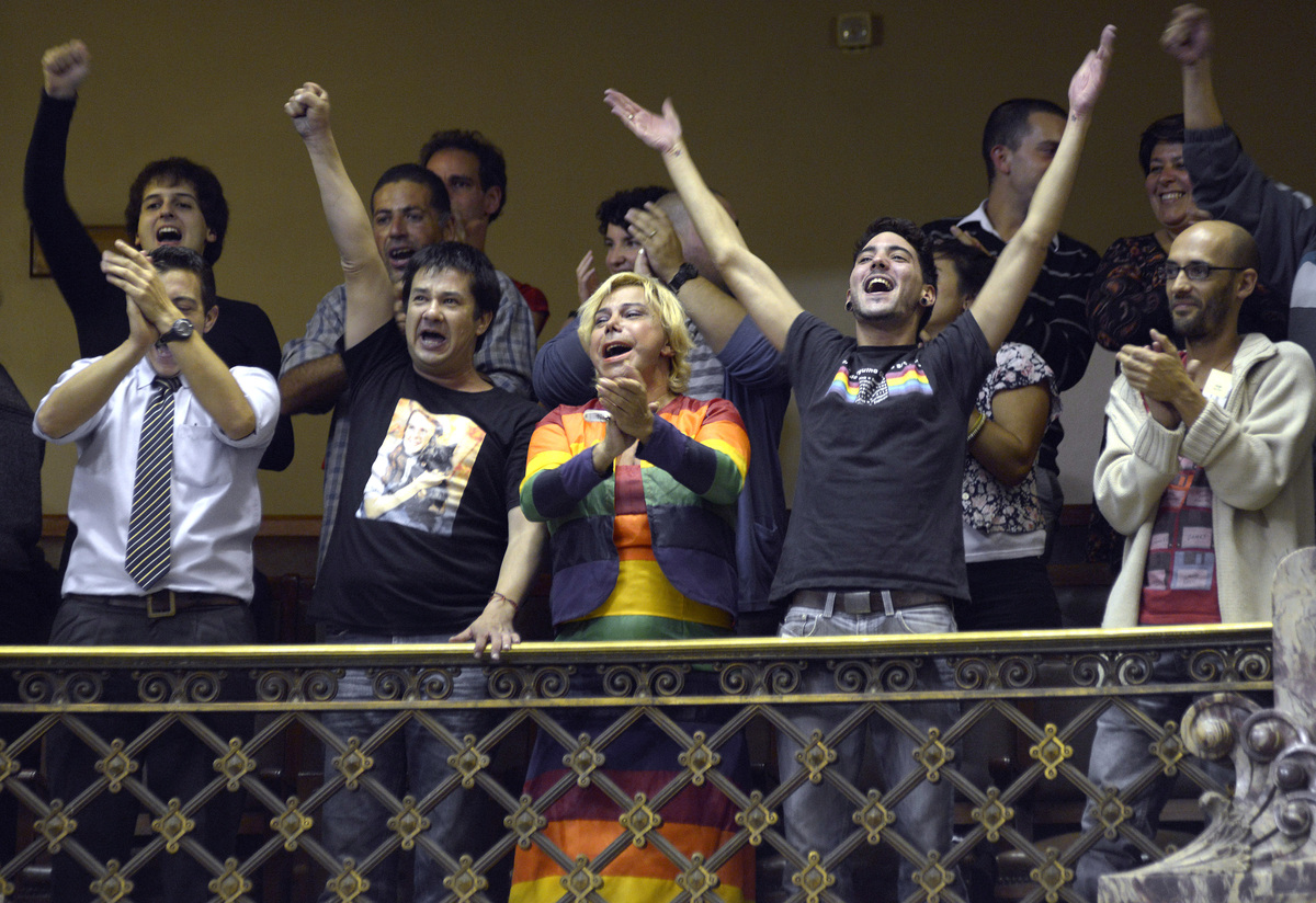 People celebrate in parliament after lawmakers voted to legalize gay marriage in Montevideo, Uruguay,Wednesday, April 10, 201