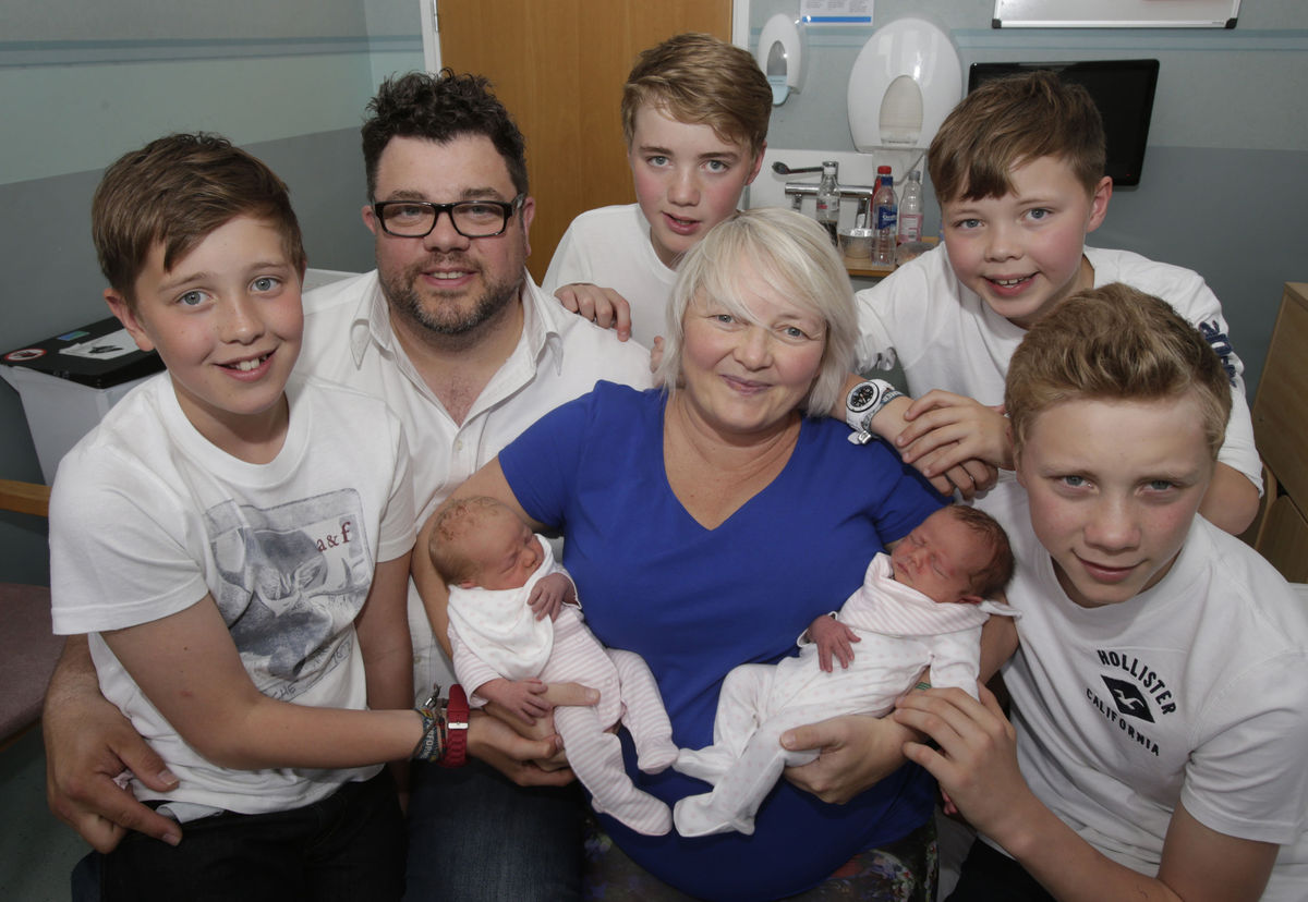Karen Rodger who defied the odds by becoming pregnant with her third set of twins is pictured holding her newborns Rowan (lef