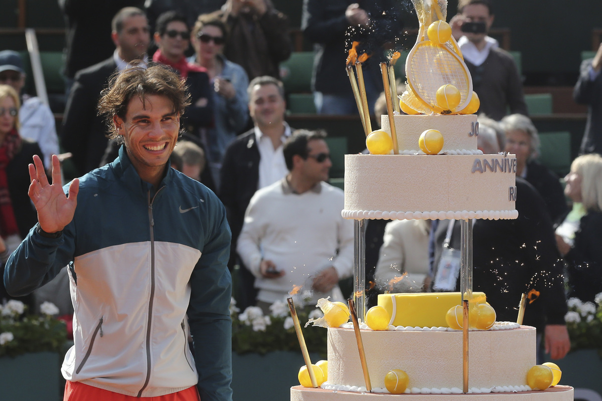 Spain's Rafael Nadal celebrates his 27th birthday on center court after defeating Japan's Kei Nishikori in three sets 6-4, 6-
