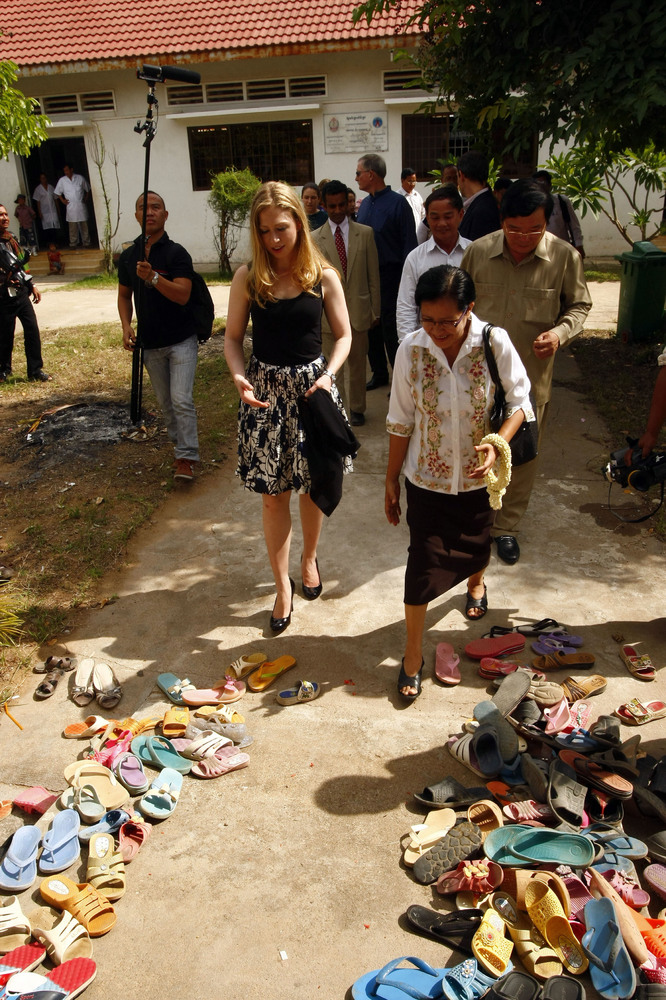 Chelsea Clinton, front left, daughter of former U.S. President Bill Clinton, tours in a hospital at Neak Loeung town, Prey Ve