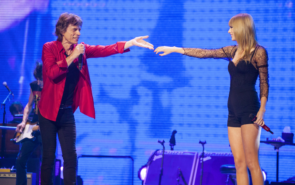Mick Jagger of the Rolling Stones and special guest Taylor Swift perform at the United Center on Monday, June 3, 2013 in Chic