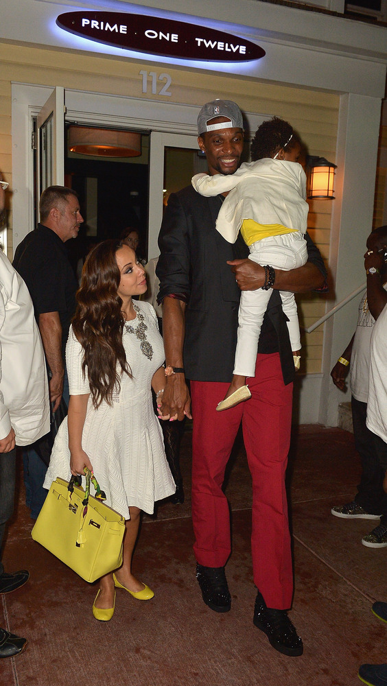 MIAMI BEACH, FL - JUNE 03:  Chris Bosh, his wife Adrienne Bosh  is sighted at Prime 112 Steakhouse on June 3, 2013 in Miami B