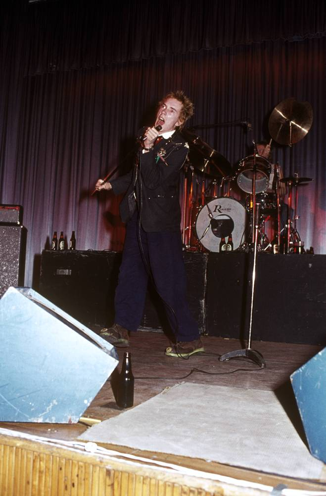 UNITED KINGDOM - OCTOBER 21  Johnny Rotten (John Lydon) and Paul Cook performing live onstage at Dunstable's Queensway Hall
