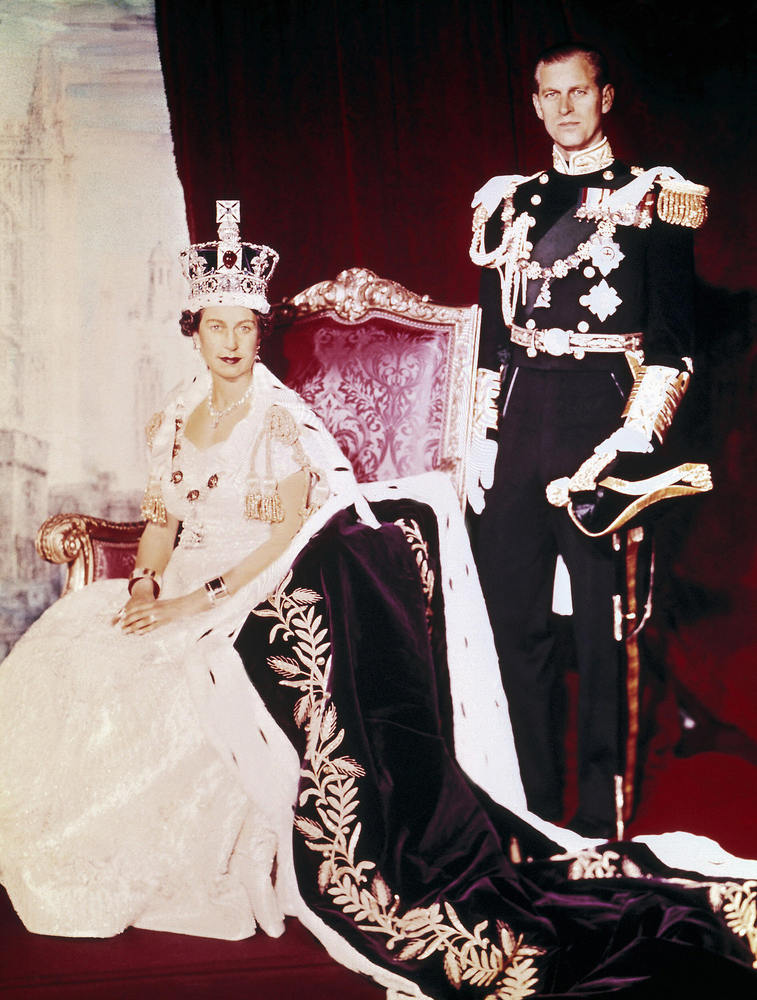 Britain's Queen Elizabeth II (L) and Prince Philip pose on the Queen's Coronation day, 02 June 1953, in Buckingham Palace, in
