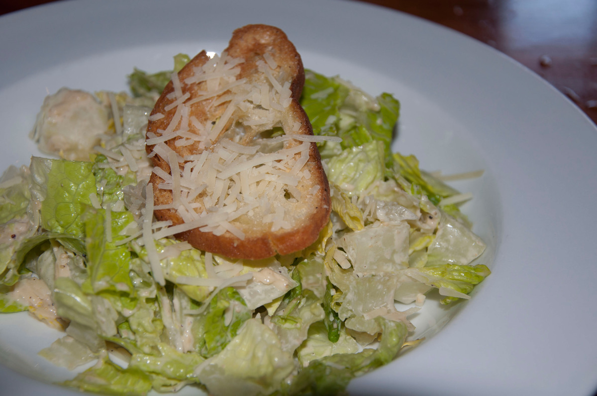 Skip the Caesar salad salad topped with Parmesan cheese and white bread or croutons.