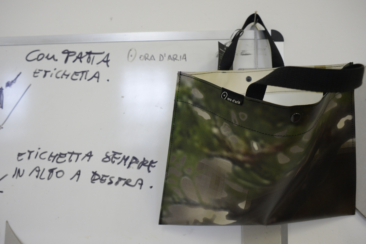 A handbag being made is displayed on May 22, 2013 at a workshop of Rebibbia prison in Rome. Women's prison workshops across I