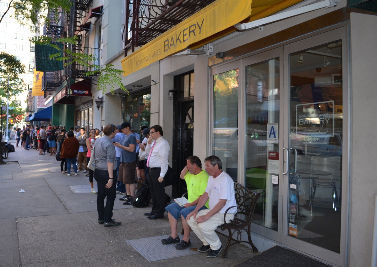 At 6 a.m. on a June Wednesday, a line began to form outside Dominique Ansel Bakery in Manhattan. By 6:30 a.m., it stretched d
