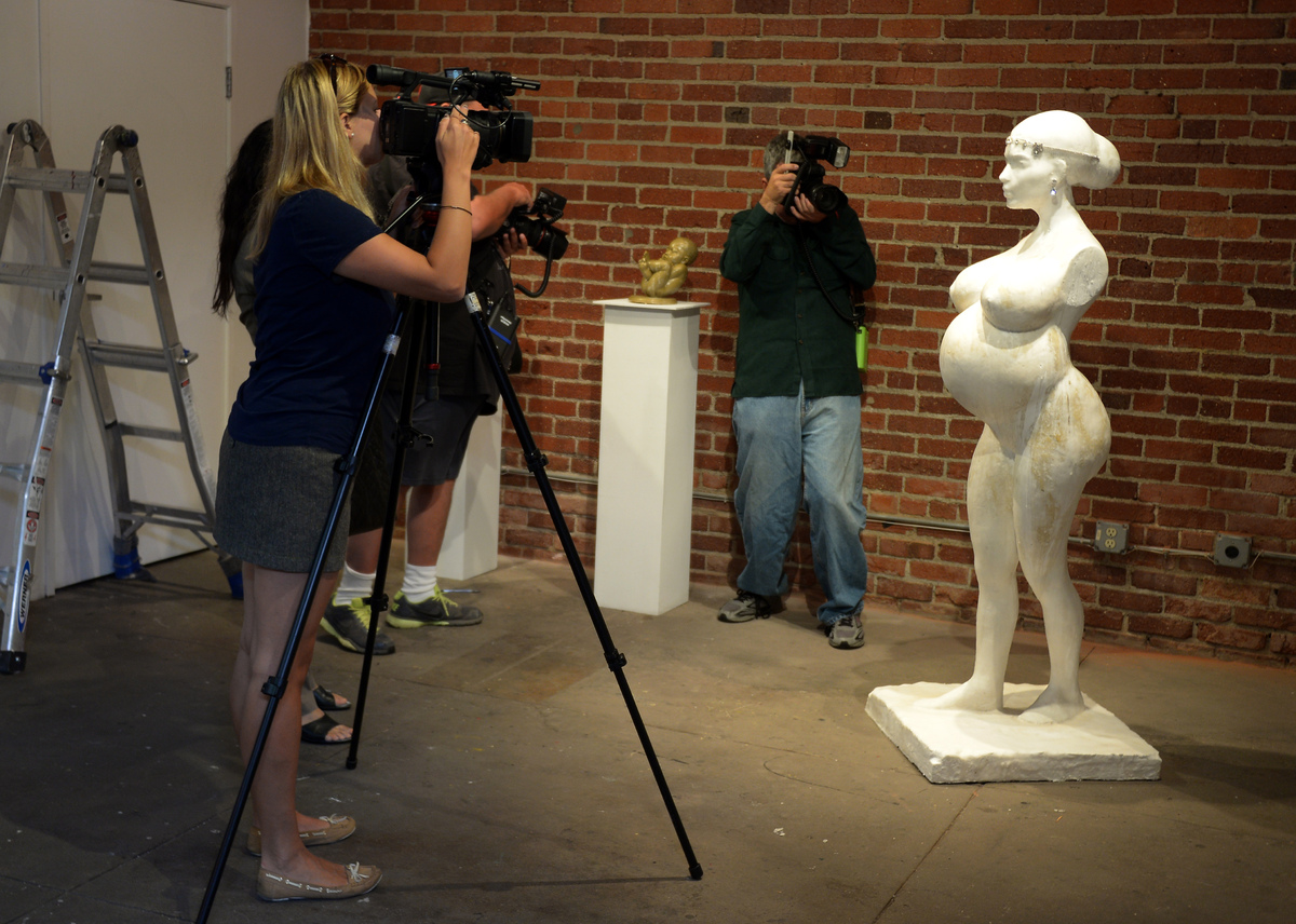 Artist Daniel Edward presents his new sculpture of pregnant celebrity Kim Kardashian, with the belly fully accessible for vis