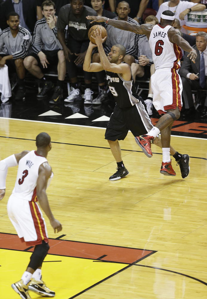 San Antonio Spurs point guard Tony Parker (9) makes the final shot of the game against the Miami Heat during the second half