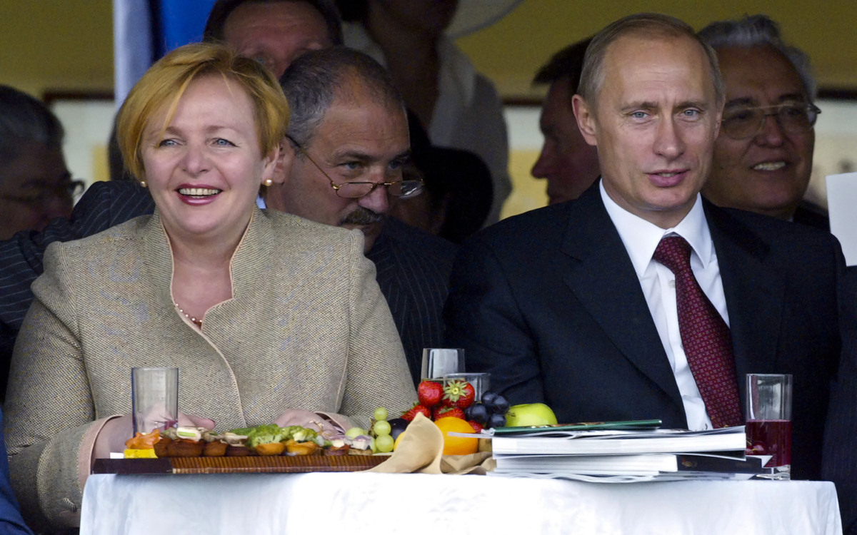 In this file photo taken on July 3, 2004, President Vladimir Putin and then his wife Lyudmila watch during horse races at the