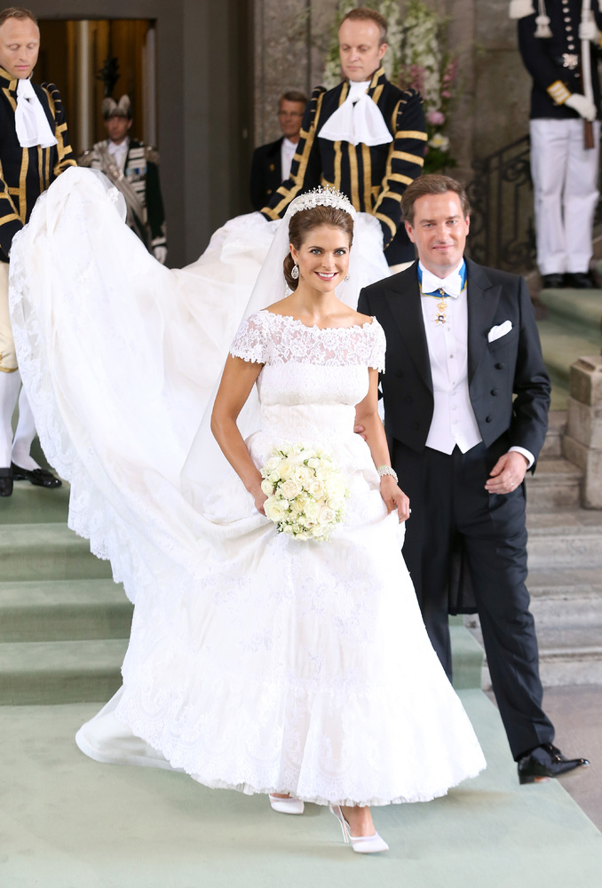 STOCKHOLM, SWEDEN - JUNE 08: Princess Madeleine of Sweden and Christopher O'Neill depart from the wedding ceremony of Princes