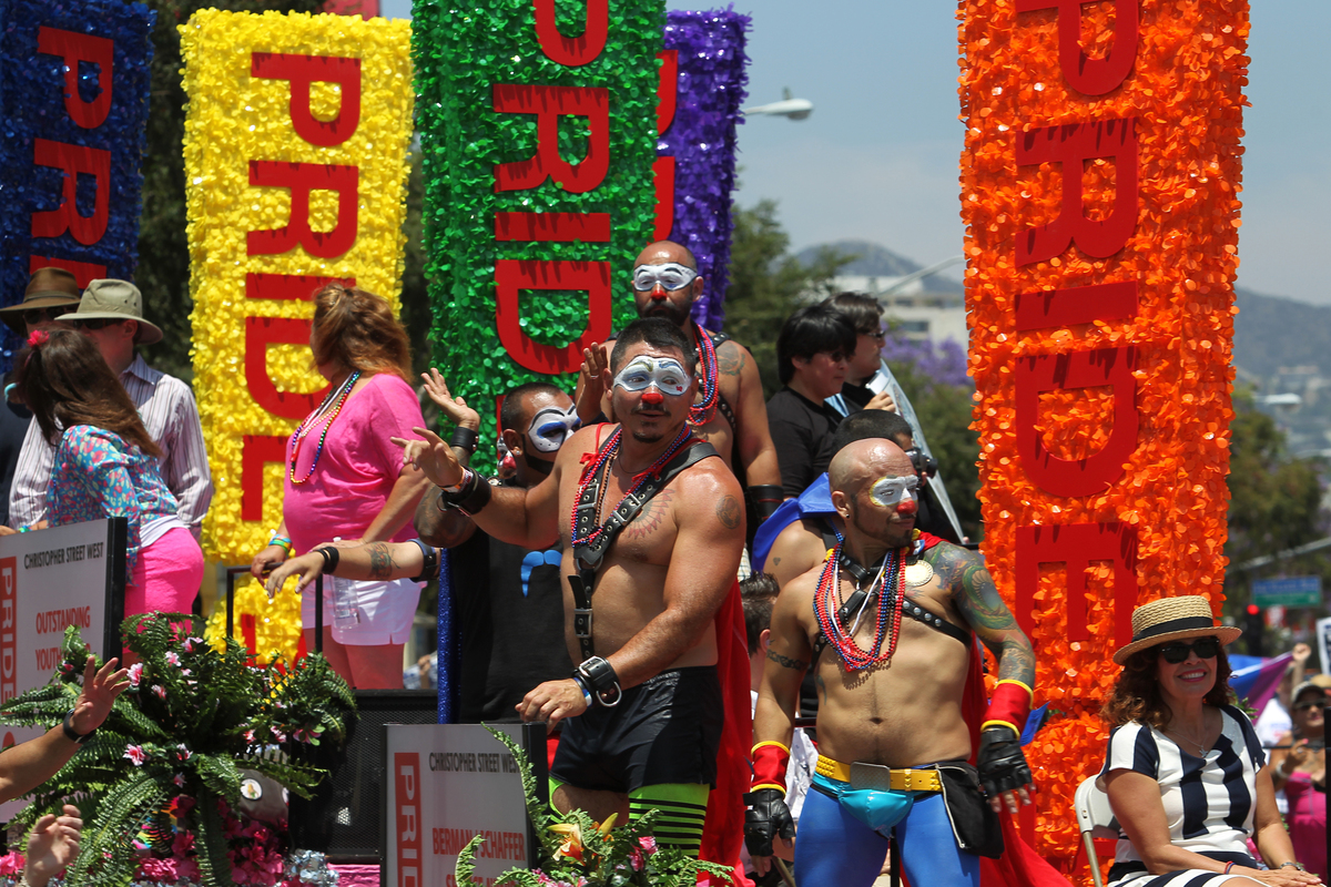 People ride on a float in the 43rd L.A. Pride Parade on June 9, 2013 in West Hollywood, California. (Photo by David McNew/Get