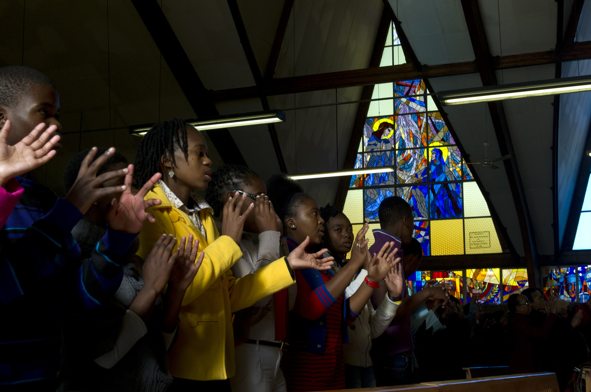 Members of the congregation at the Regina Mundi church in Soweto, a flashpoint during the anti-apartheid struggle, pray on Ju
