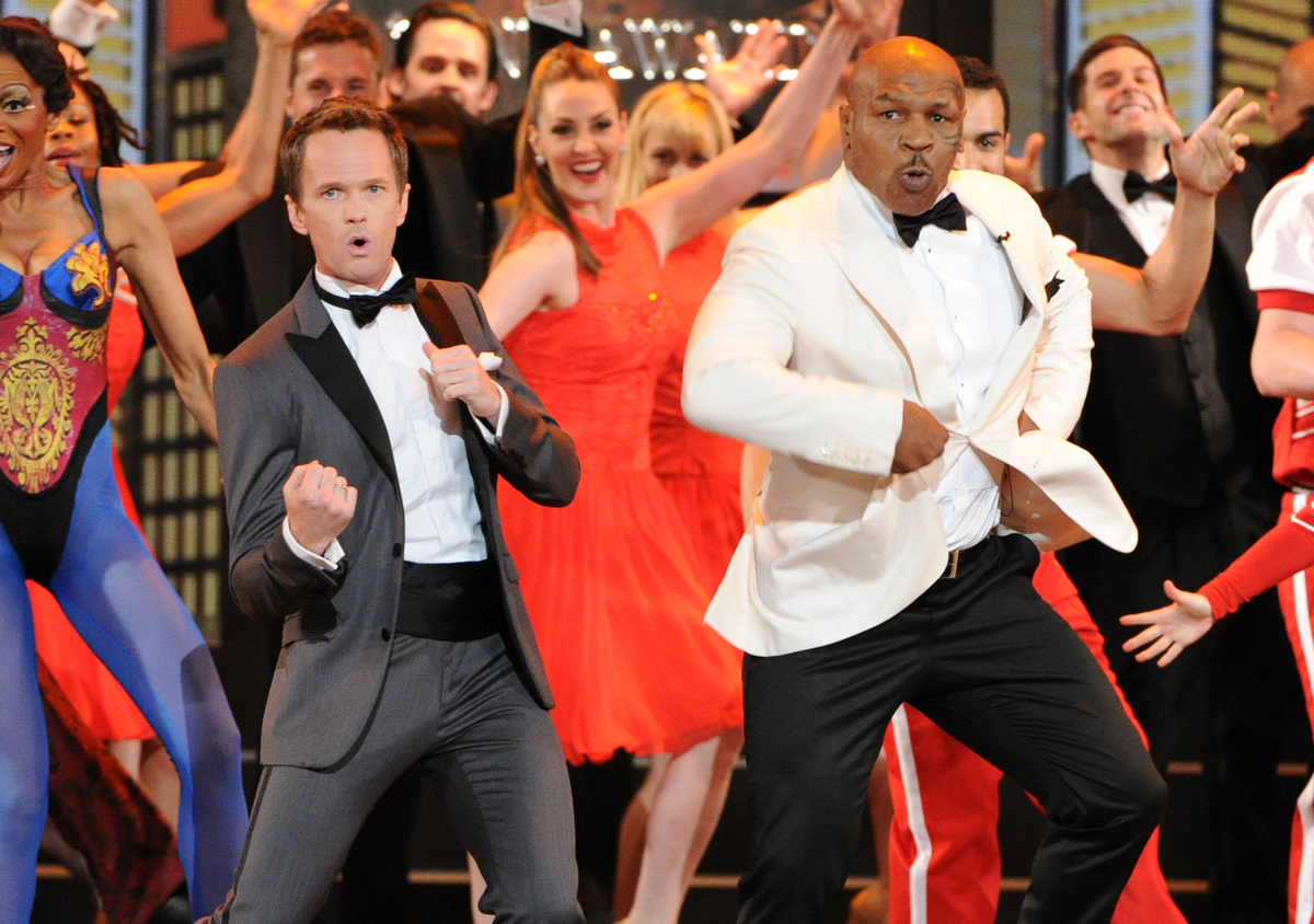 Actor Neil Patrick Harris, left, and Mike Tyson perform on stage at the 67th Annual Tony Awards, on Sunday, June 9, 2013 in N
