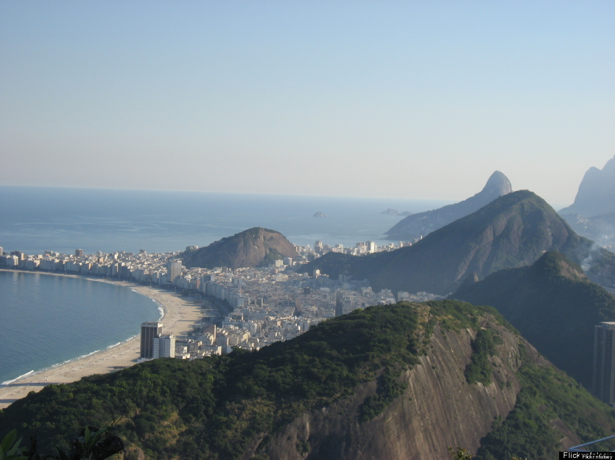 No trip to Rio is complete without a stop at Copacabana. This two-and-a-half mile stretch of sand is busy with sunbathing, ki