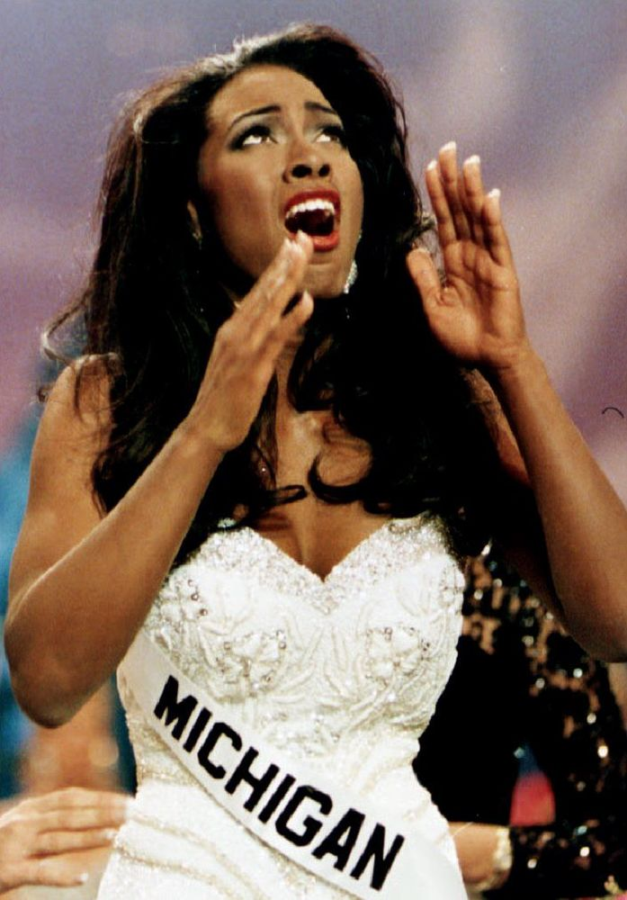 Kenya Moore, Miss Michigan USA, a 22-year-old Wayne State University student, reacts after winning the Miss USA 1993 title la