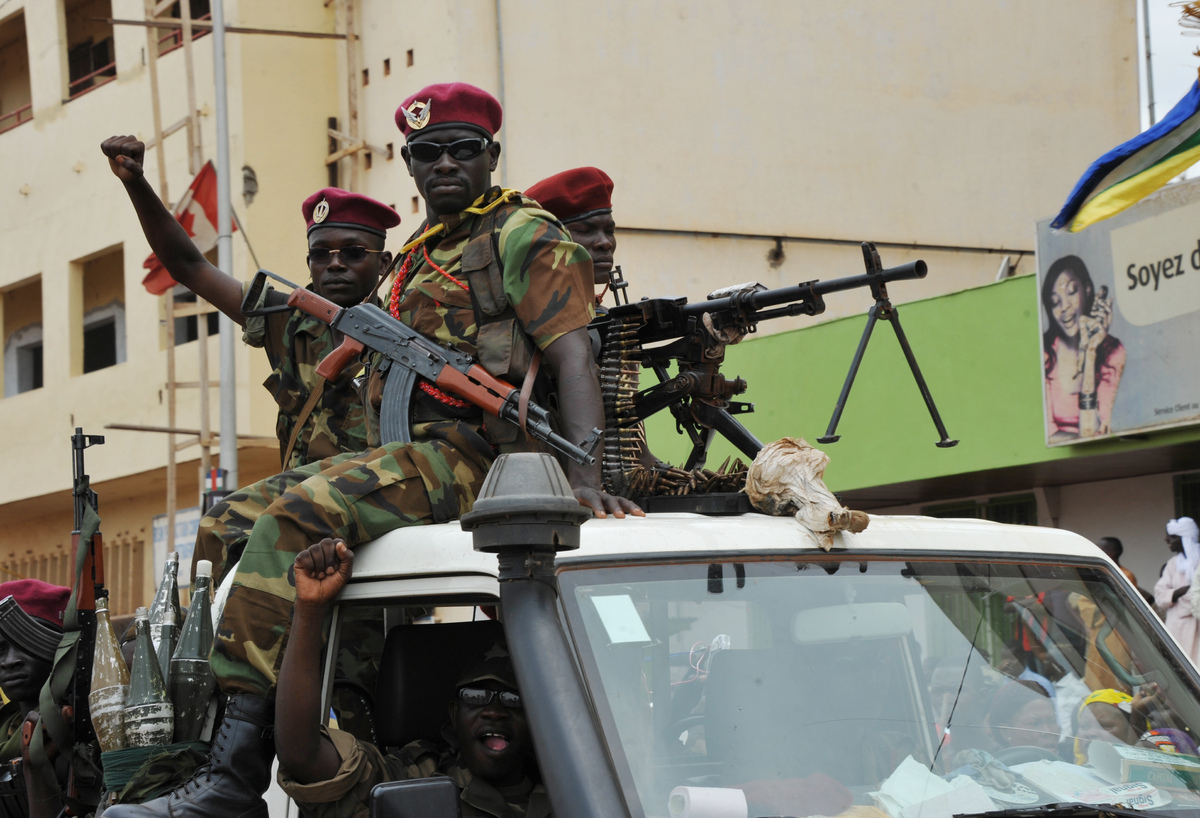 <em>This picture taken on March 30, 2013 shows armed Seleka rebels on a pick-up truck during a meeting of the rebel strongman