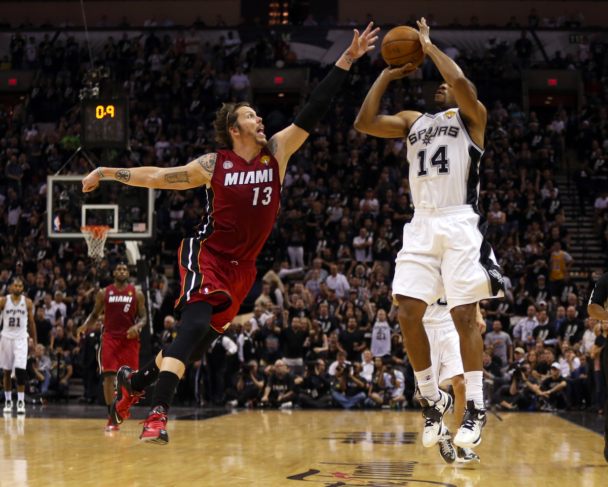 SAN ANTONIO, TX - JUNE 11:  Gary Neal #14 of the San Antonio Spurs makes a three pointer over Mike Miller #13 of the Miami He