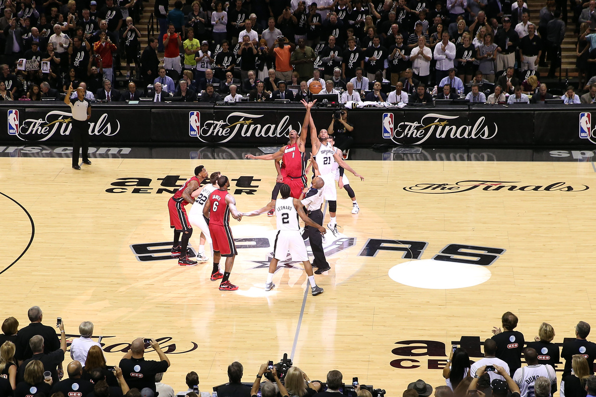 SAN ANTONIO, TX - JUNE 11:  Chris Bosh #1 of the Miami Heat and Tim Duncan #21 of the San Antonio Spurs go after the opening