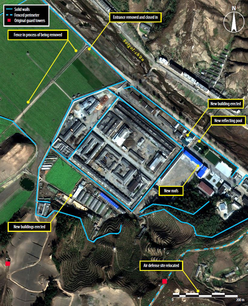 This is a satellite image of new buildings and removal of a fenceline.  Also, new roofs have been installed on the barracks a