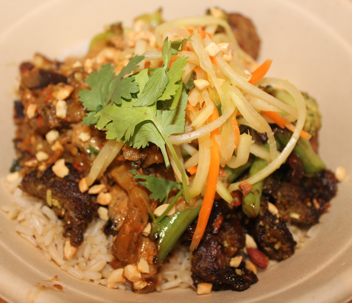 Grilled Steak Laab rice bowl with green beans, green papaya slaw and crushed peanuts.