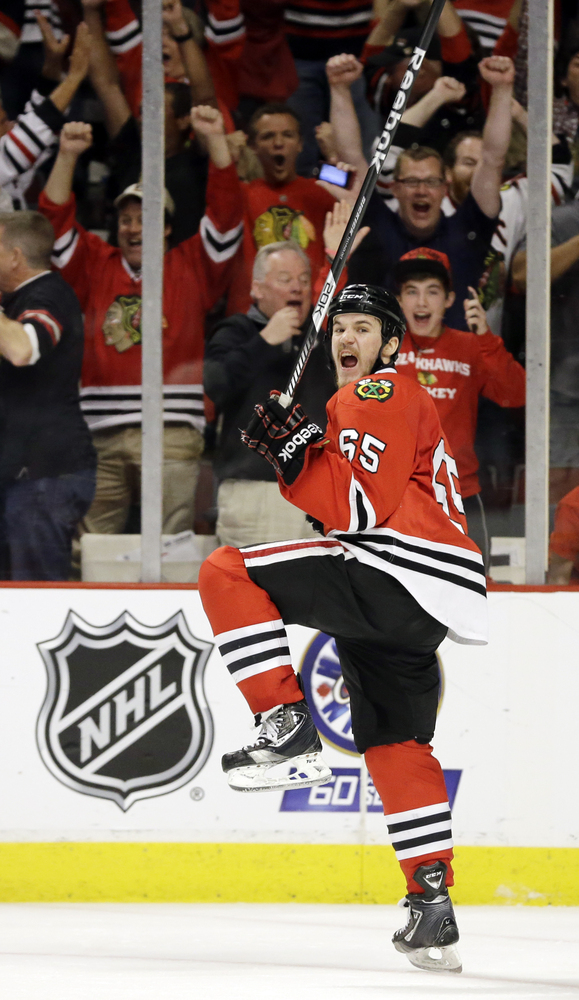 Chicago Blackhawks center Andrew Shaw (65) celebrates after scoring the winning goal during the third overtime period of Game
