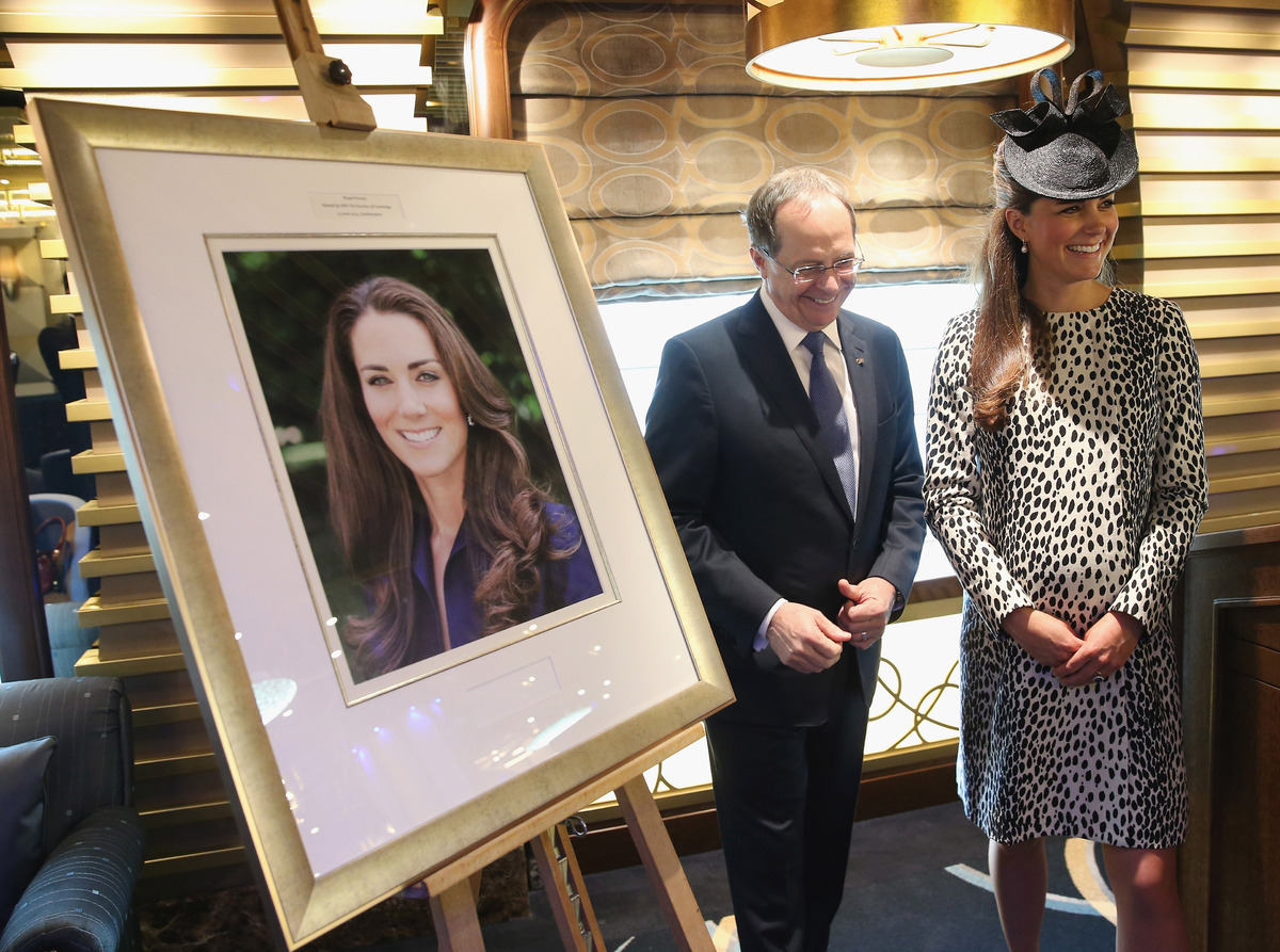 President and CEO of Princess Cruises Alan Buckelew with the Duchess of Cambridge as she looks at an image taken of herself b