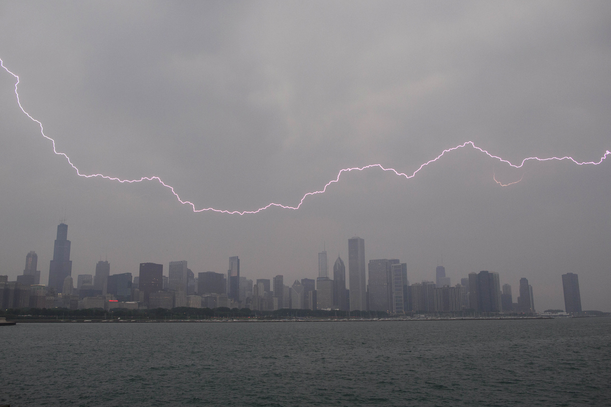 Lighting flashes over the Chicago skyline, Wednesday, June 12, 2013. (AP Photo/Scott Eisen)