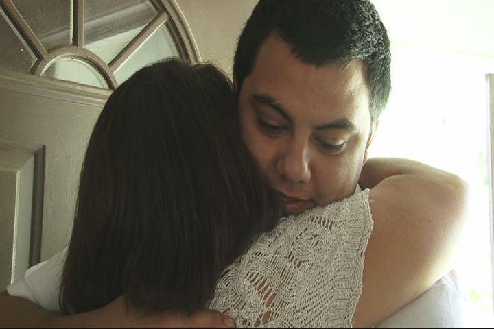 Cherie Alvis hugs her son, Clark Alldridge, after being apart for 22 years.