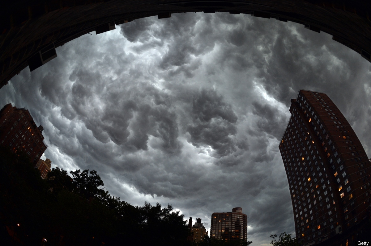 Clouds gather over apartment buildings ahead of a thunderstorm on the east side of Manhattan July 26, 2012 in New York. AFP P