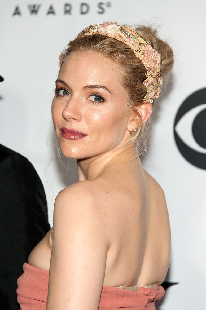 Miller wins for the best floral headband we have seen in a very long time. She looks so youthful, and her burgundy lipstick a