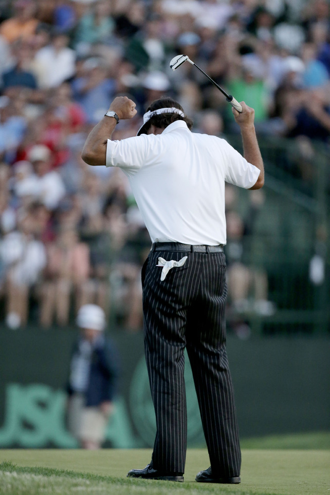 Phil Mickelson reacts to a putt on the 18th green during the second round of the U.S. Open golf tournament at Merion Golf Clu