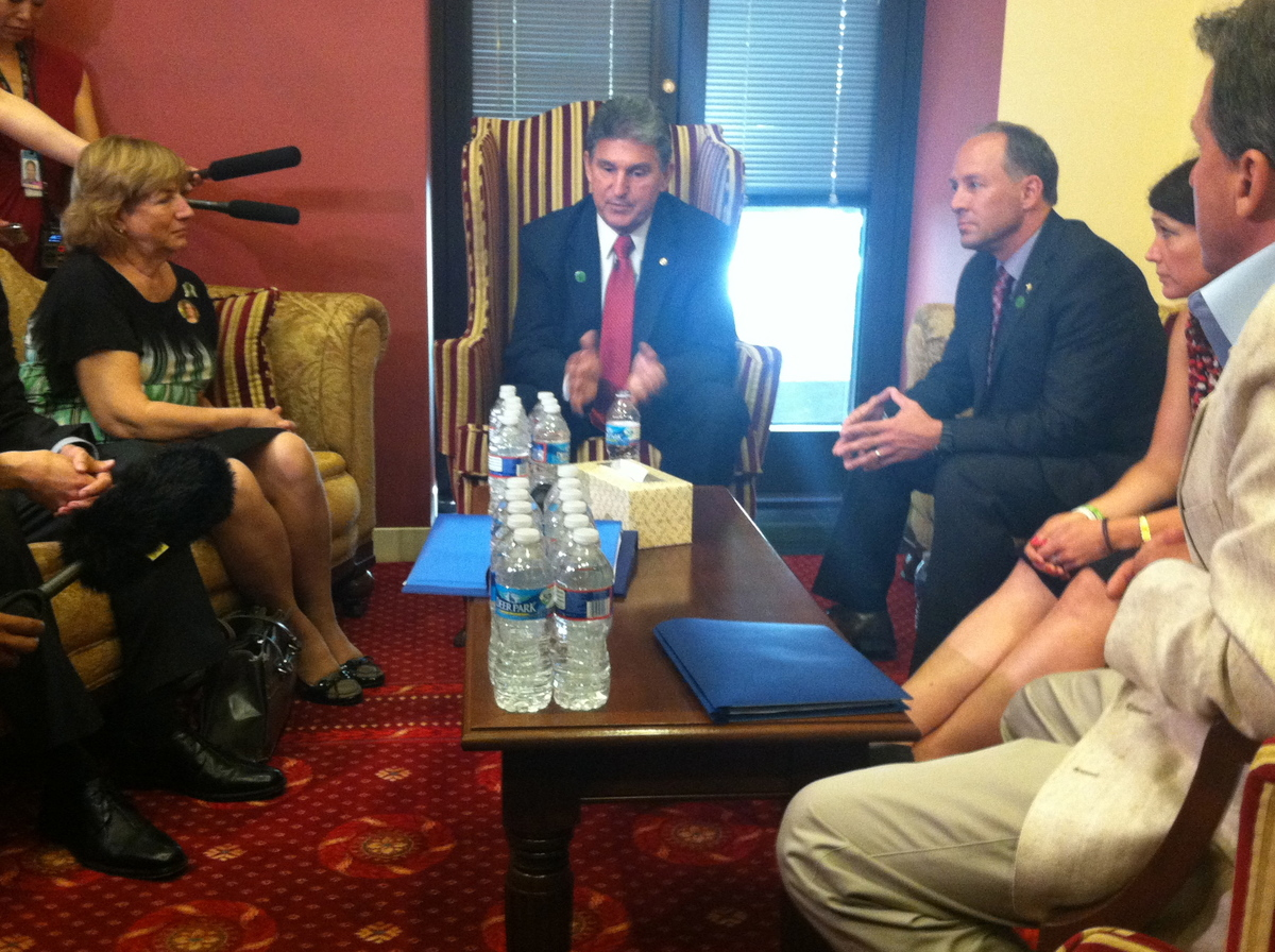 Sen. Joe Manchin (D-W.Va.) talks with eight family members of the Newtown, Conn., shooting victims during a gathering in his