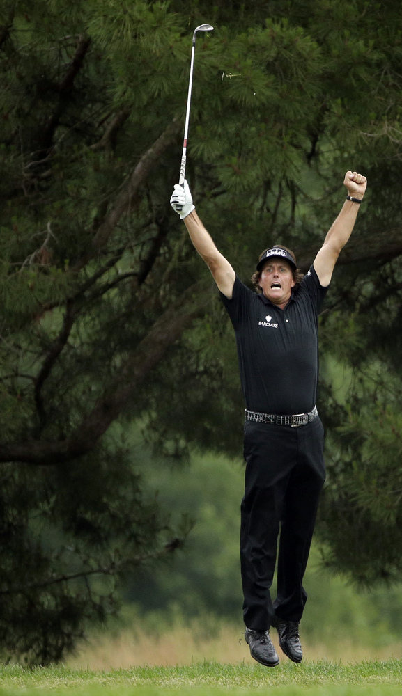 Phil Mickelson reacts after hitting an eagle on the 10th hole during the fourth round of the U.S. Open golf tournament at Mer