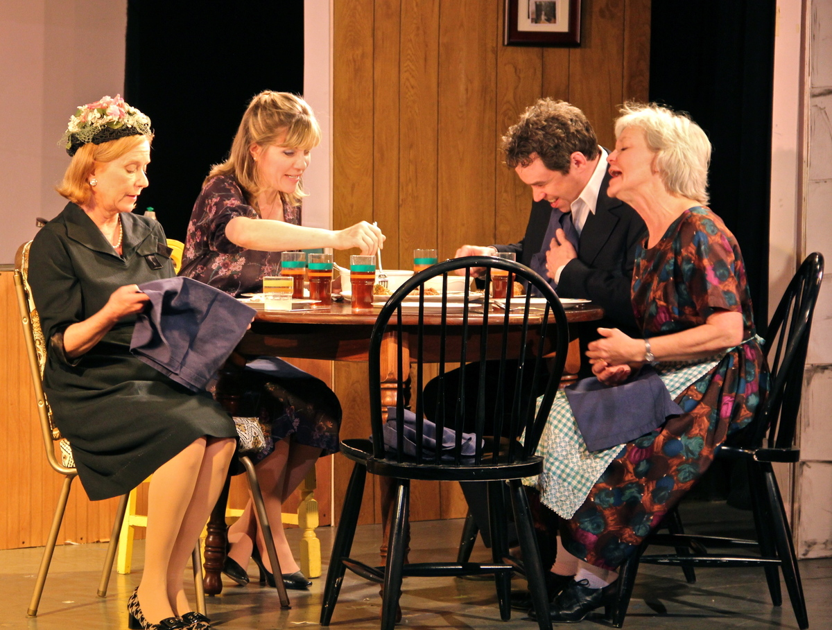Aunt June (played by Eve Plumb), Cheryl (Lori Hammel), Bobby (James Wesley) and Ruby (Suzanna Hay) sit around the table tryin