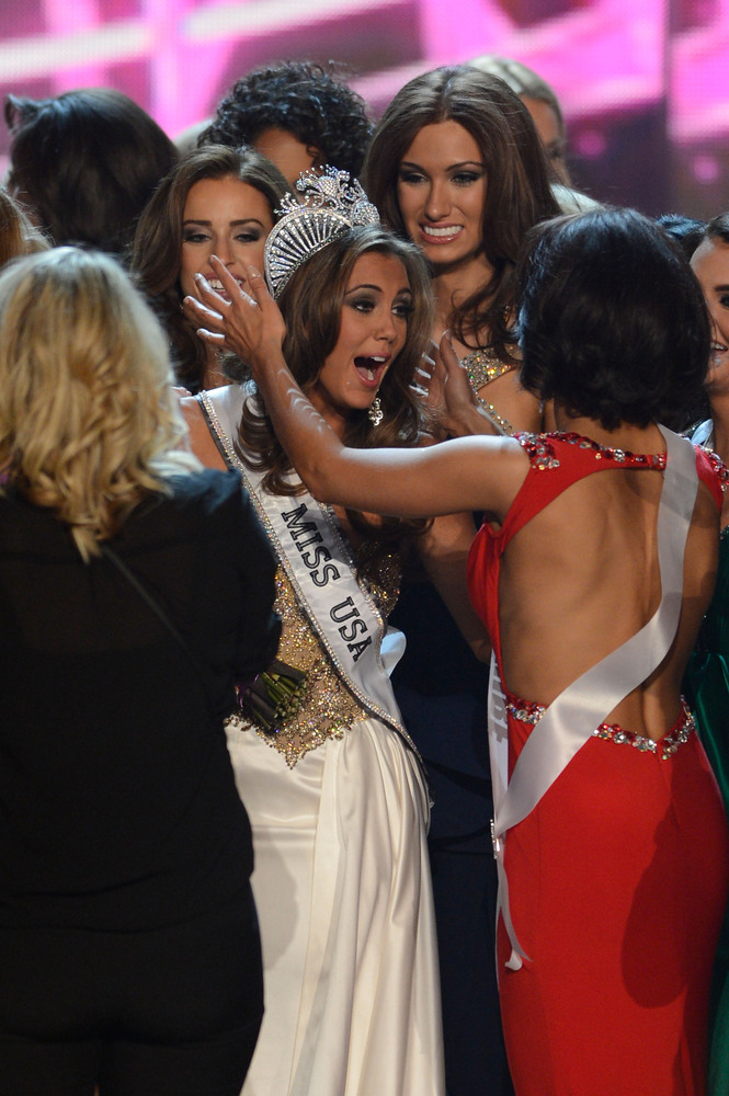Miss Connecticut Erin Brady, center, reacts after winning the Miss USA 2013 pageant, Sunday, June 16, 2013, in Las Vegas. (AP