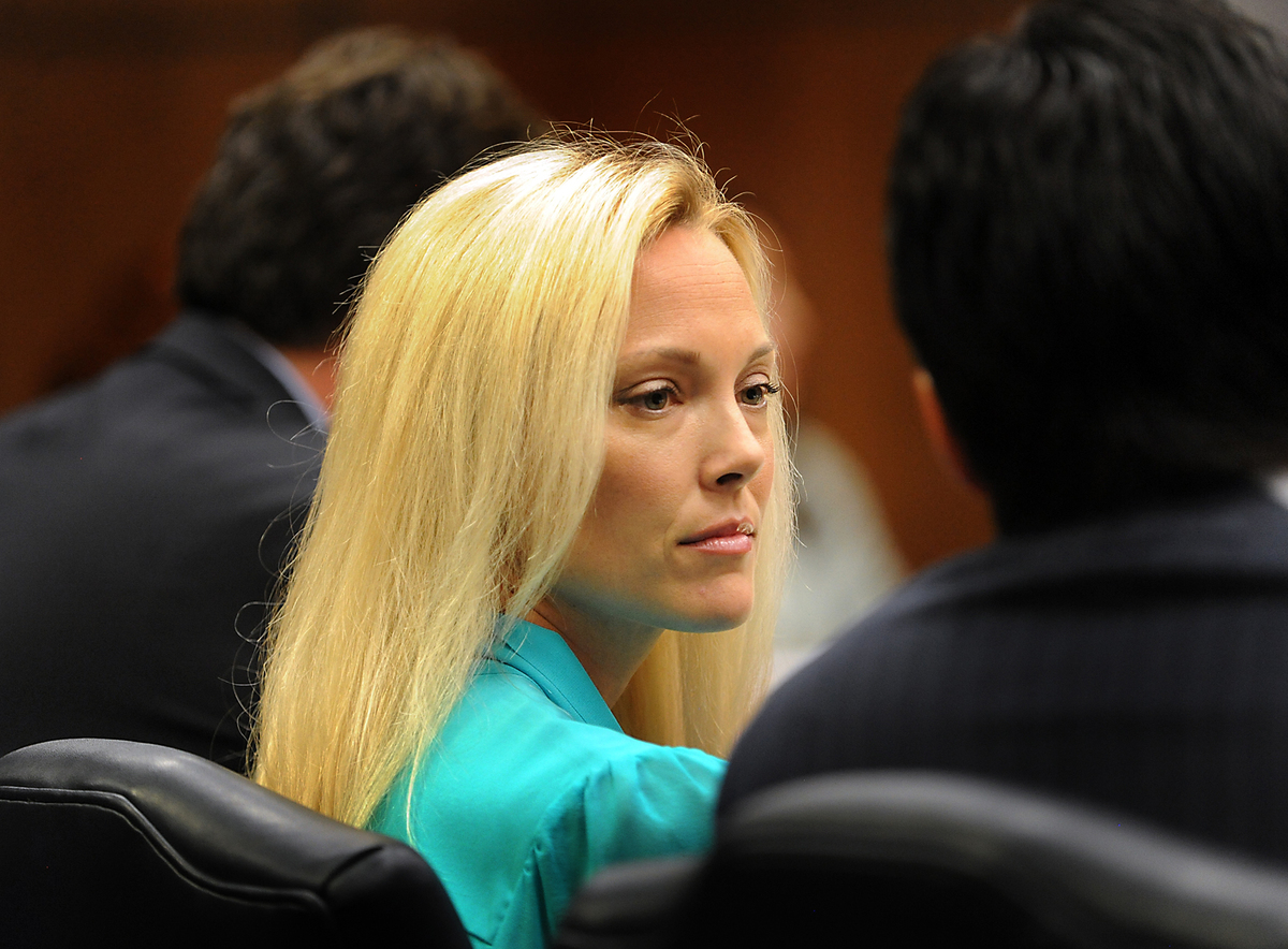 Jamie Aguiar, wife of Guma Aguiar, listens to one of her attorney on July 3, 2012, during a hearing concerning her missing hu