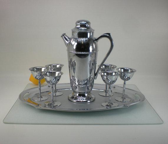 "First up's a chrome art deco-era cocktail shaker bar set.   Credit: <a href=""http://www.etsy.com/listing/151156021/chrome-art"