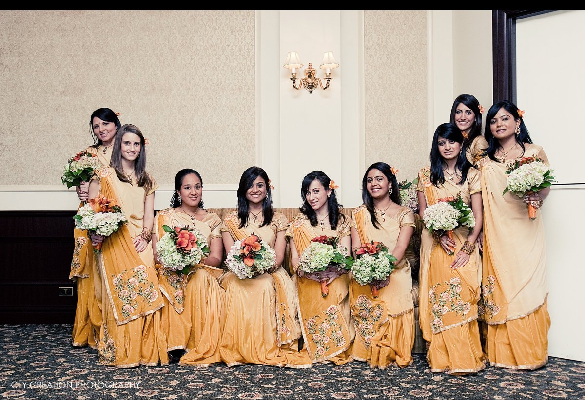 """Matching outfits can act as a """"uniform"""" for an otherwise diverse and multicultural bridal party. Everyone will know exactly w"""